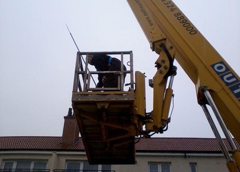 C Hanlon roofers preparing to ascend