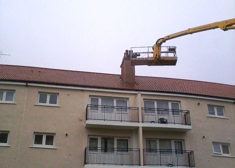 Chimney repairs underway with MEWP in position