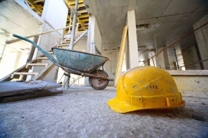 Construction site Wheelbarrow and Hard hat
