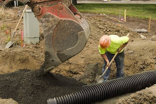 Pipe laying and trench backfilling