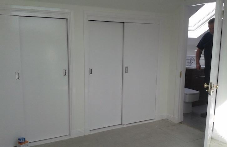 attic bedroom with sliding doors