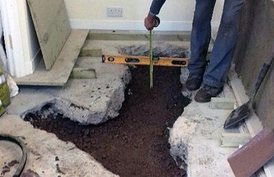 Drainage diversion and repairs garage floor excavation Glasgow