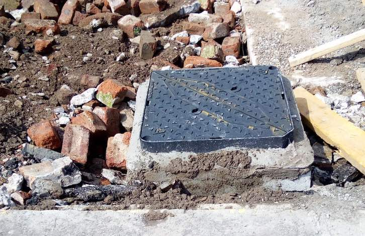 Manhole cover installed for drainage access C Hanlon Drainage Glasgow